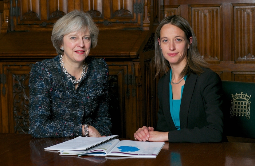 Theresa May and Helen Whately