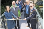 Cutting the ribbon on the restored footbridge